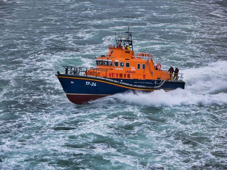 Aberdeen RNLI Lifeboat at sea, travelling at speed - this is a Severn class, self-righting, all-weather lifeboat with a crew of 7. The boat has a top speed of 25 knots and a range of 250 nautical miles. Editoriali