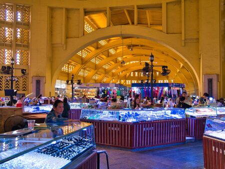 Traders in the Central Market building in Phnom Penh, Cambodia.