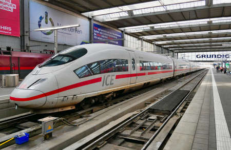 A Deutche Bahn (DB) Intercity Express (ICE) train waits at a platform at Munich Railway Station. Publikacyjne