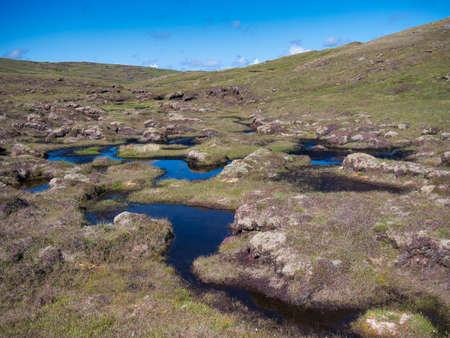 A wetland area forming peat near Hoo Field, Voe on Mainland, Shetland, UK