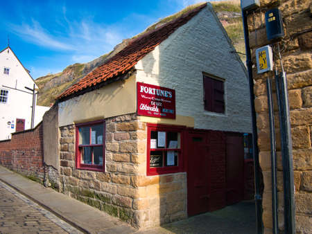 The shop and smokehouse of traditional kipper smokers, Fortunes of Whitby - a business run by generations of the Fortune family since 1872. 新闻类图片