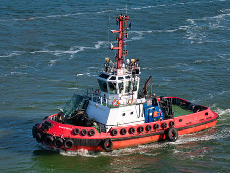 The tug Masterman operating in Belfast Harbour on a calm and sunny evening in June 2021. The tug was built in 2009 and sails under the flag of the UK.