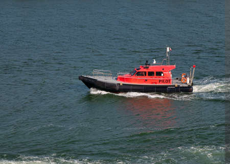 A Pilot boat operating in Belfast Harbour on a calm sunny evening in June 2021