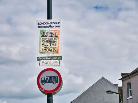 An anti abortion - pro-life message from the Irish Aontu political party on a placard fixed to a lamp post in Armagh, Northern Ireland, UK Editorial