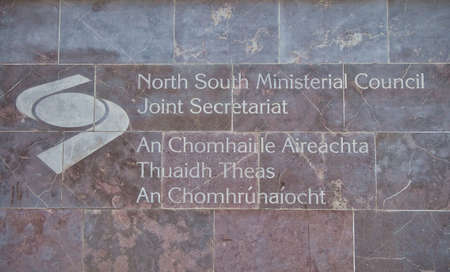 Signage outside the North South Ministerial Council, established under the Belfast Good Friday Agreement, to develop consultation, co-operation and action within the island of Ireland