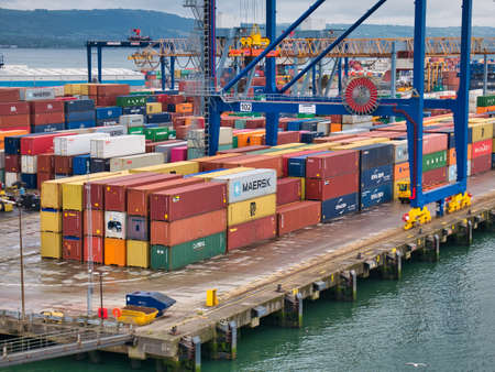 Shipping containers stacked at the Belfast Harbour container terminal on an overcast Sunday morning in July 2021 Editorial