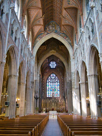 The interior of St Patrick's Roman Catholic Cathedral in Armagh - taken on a sunny day with blue sky and white clouds Editorial