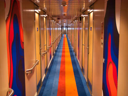 A deserted corridor providing access  to passenger cabins aboard a Stena Line ferry running between Belfast and Liverpool.
