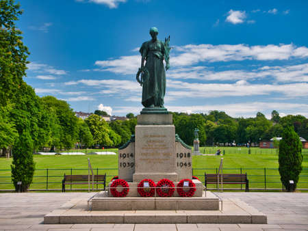 The Armagh Cenotaph remembering the dead of two World Wars. Taken on a sunny day with blue sky and light clouds. The memorial is off College Hill opposite the Courthouse.