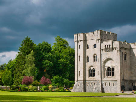 The 19th-century country house and gardens of Gosford Castle, situated in Gosford Forest Park near Markethill, County Armagh, Northern Ireland. Taken on a sunny day with cloud. Editorial