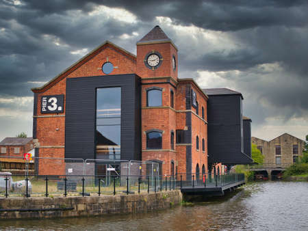 Warehouse buildings at Wigan Pier on the Leeds - Liverpool Canal. Now under redevelopment for housing and public access areas including a food hall and event centre.