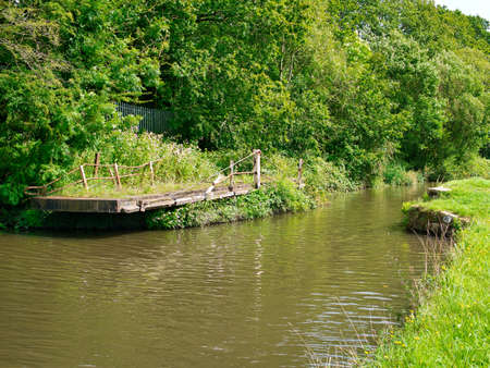 A derelict, disused swing bridge on the Leeds to Liverpool canal in Lancashire, England, UK