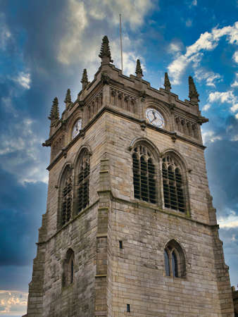 Constructed of sandstone and built in the perpendicular style, the Grade 2 listed building of the Anglican All Saints' Parish Church in Wigan, Lancashire, UK.