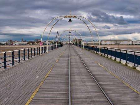 A view from the end of the famous, 1,108 metre long Southport Pier in the northwest UK. Opened in August 1860, it is the oldest iron pier in the UK. Editorial