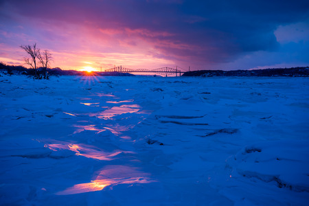 Cold winter sunset over the St. Laurent river Stock fotó