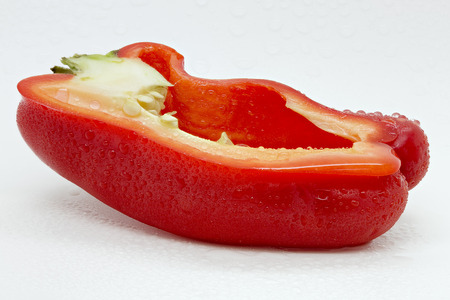 Macro shot of a half pepper covered with droplets Stock fotó