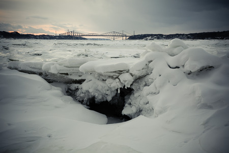 Cold sunset over the St. Laurent river Stock fotó