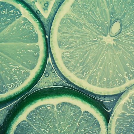 Artistic macro shot of limes and lemons