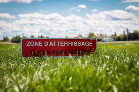 Landing Zone - No One Allowed written in french. This sign is installed near a parachute landing zone.