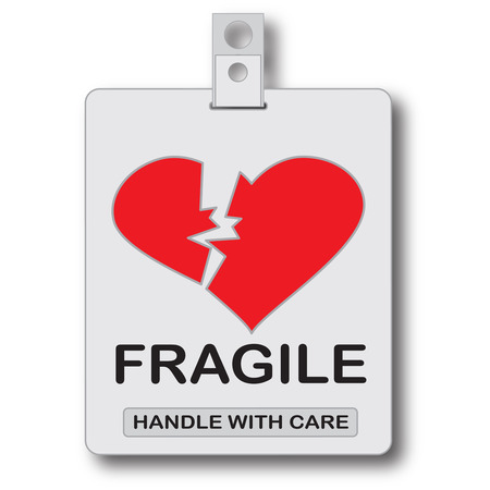 replaced: Fragile, handle with care id card. The box is replaced by a heart. Stock Photo
