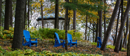 Picture of four beautiful wooden adirondack chairs