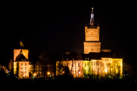 Old german castle tower clock palace at night
