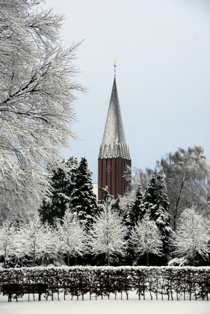 Sad white and grey winter scenery public park and church