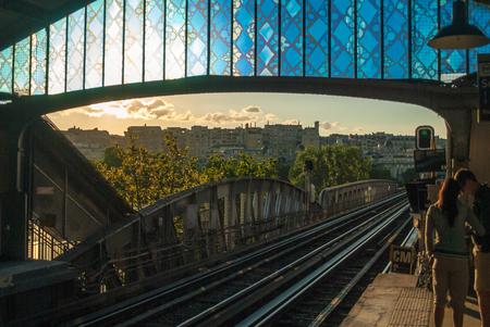 Old metro tram station in Paris sunset sunlight evening rails Stock Photo