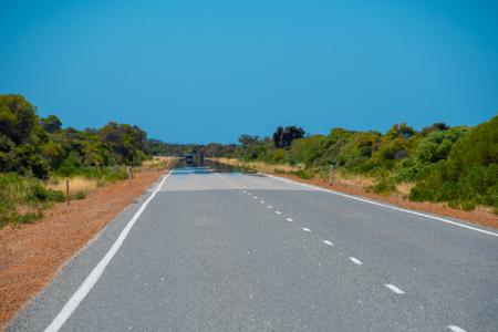 Fata Morgana mirage showing on the hot road Australia Stockfoto