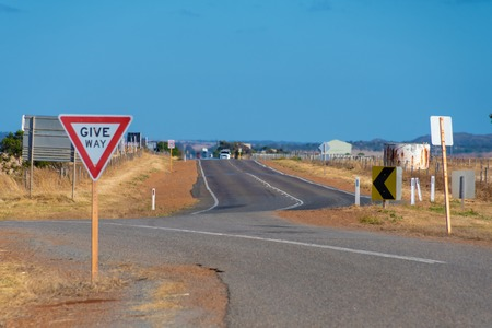 Give Way street sign at on of Australias endless Outback roads