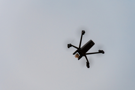 Drone aka unmanned airborne vehicle taking aerial pictures and videos