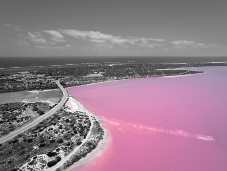 Aerial image in black and white of the Pink Lake and Gregory in Western Australia with Indian Ocean