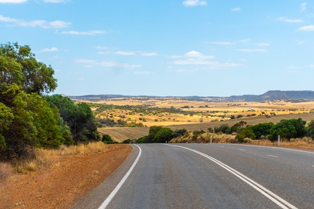 Landscape of Western Australia besides the road with hills and farmland Stock Photo