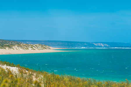 Windy beach of Gregory in Western Australia with sand dunes in the foreground