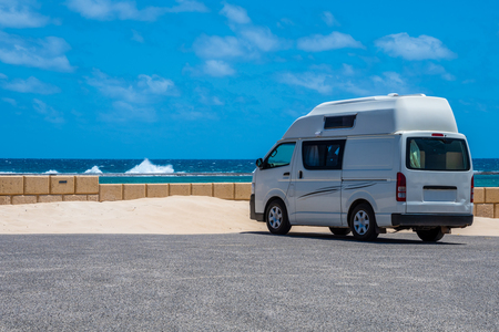 Campervan parking at the beach of Gregory in Western Australia during windy but clear day