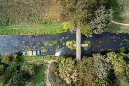 Aerial image of a bridge and a water inlet in the river Niers in West Germany