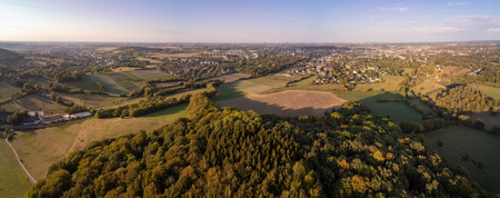 Aerial panorama of meadows and forrests next to the West German city Aachen in the Eifel region