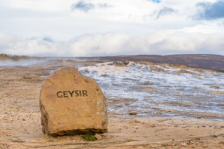 Geysir Golden Circle in Iceland name cut in rock in front of the geothermal area
