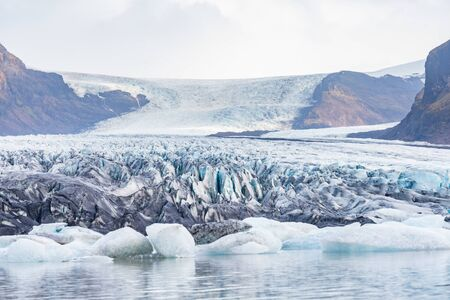 Vatnajoekull glacier in Iceland deep blue ice and layers of ash from volcano