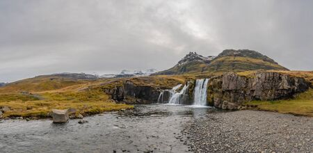 Kirkjufell in Iceland Kirkjufellsfoss waterfall panorama of complete setting during autumn