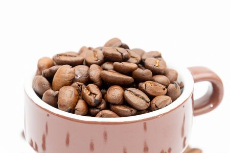 Espresso cup in brown filled up with roasted coffee beans 版權商用圖片