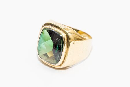 Old gold ring carrying big emerald deep green and precious many small flaws Stock Photo