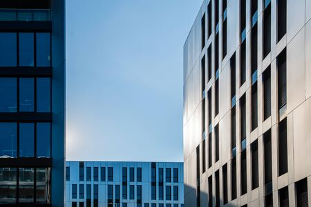 Different types of modern office building facades in front of blue sky Stockfoto