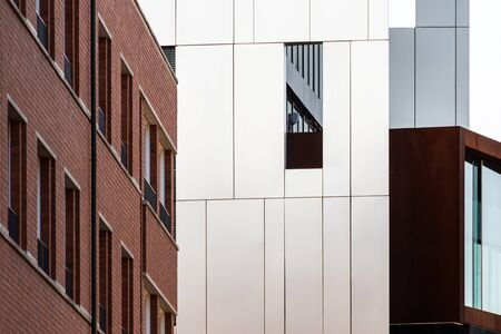 Different types of modern building facades made of steel sheets or dutch bricks