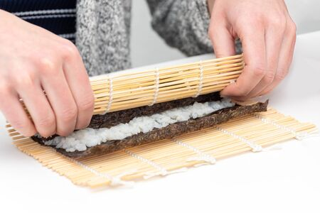 Sushi roll Japanese dish rolling dish by hand