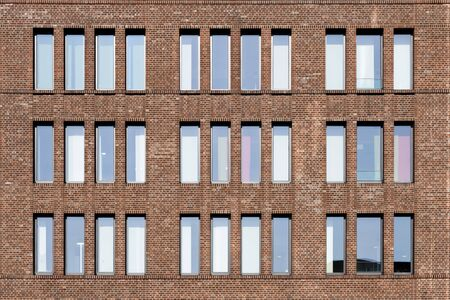 Dutch clinker brick facade in different brown and red tones with high and narrow window Stockfoto