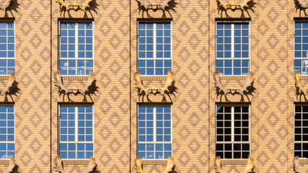 Beige dutch brick facade texture with deer antlers and diamond pattern Stockfoto