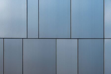 Stainless steel facade cladding shining in different grey and blue tones building elements