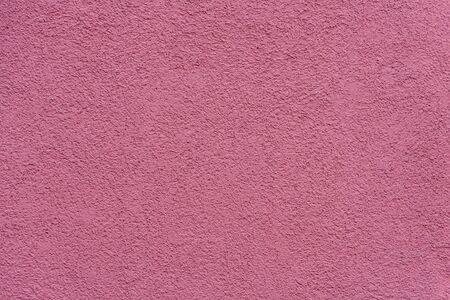 Texture of pink or purple painted and plastered building wall Stockfoto