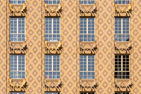 Beige dutch brick facade with deer antlers and diamond brick pattern